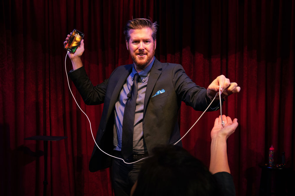 Bryan Saint magically charging someone's phone at the Magic Castle